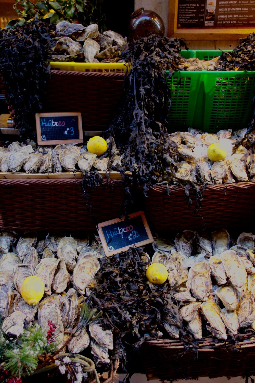 No 2 and No 3 oysters displayed in a street market.