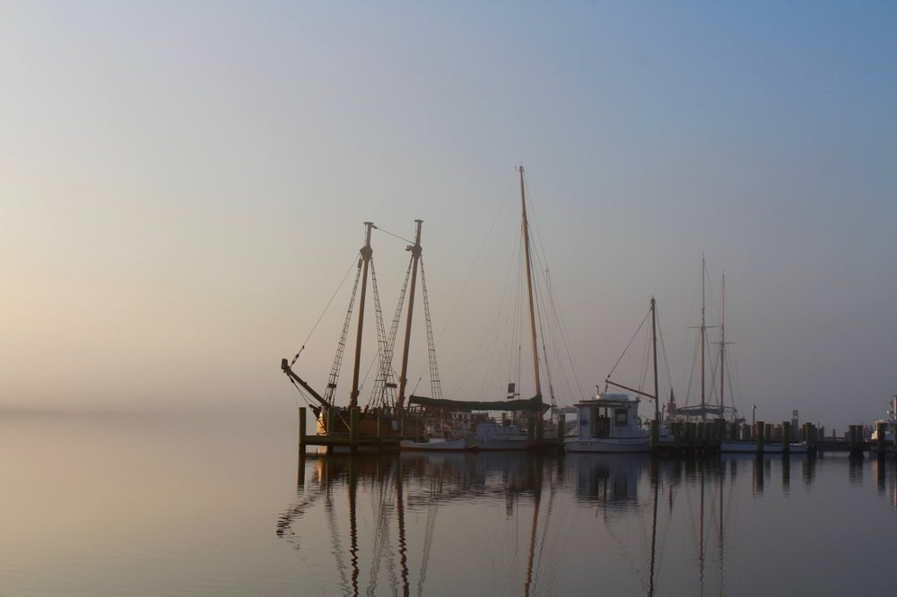 The unusually warm weather has created some incredibly beautiful foggy mornings around the Chesapeake this week. This image, taken in Chestertown, Maryland, is just one example of the lovely way that fog, early light, still water, and the tangled architecture of wooden boat masts and rigging seamlessly intersect on these fleeting few dawn moments.