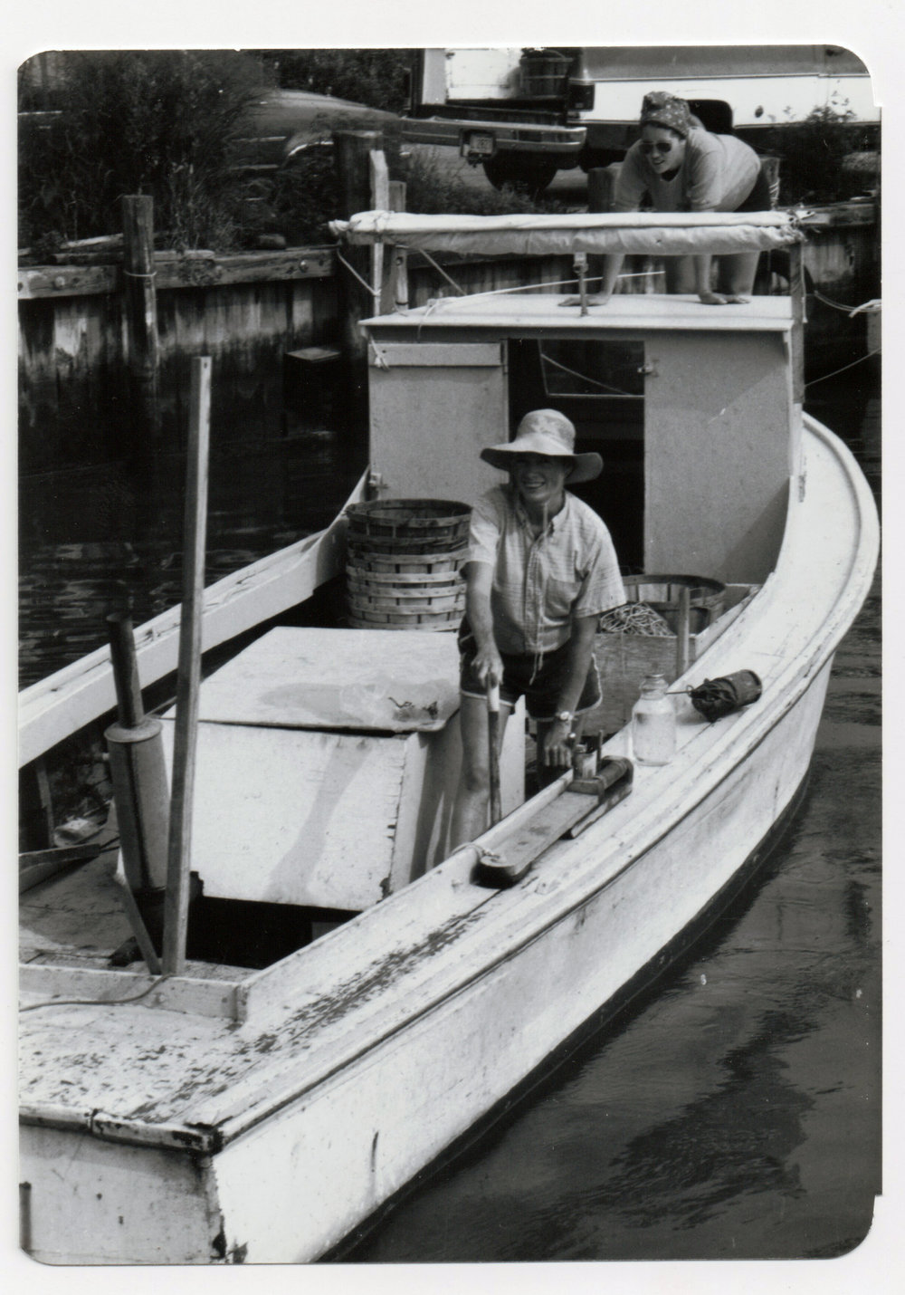 Not all Chesapeake watermen are actually men. This image taken by Lila Line in 1981, is a perfect example of the tenacity, tirelessness, and work ethic of plenty of the Bay's water-working-women. While many women work off the water in watermen families, picking crabs or placing orders, some women choose to follow the example of their fathers or brothers, buy their own boat, and make a living from what the Bay provides. In this photo, Kathleen, a Tilghman Island waterman, is heading out for a long day of crabbing, despite being heavily pregnant. She continued to work until three weeks before her son, Noah, was born.    Image by Lila Line, collections of the Chesapeake Bay Maritime Museum.