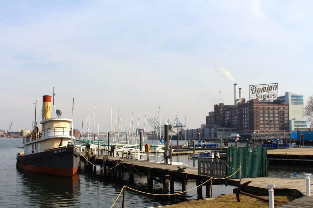 Baltimore harbor as seen from the Baltimore Museum of Industry, with the iconic Domino Sugar building in the distance. Dockside is the  S.S. Baltimore,  the oldest operating steam-powered, coal-fired tugboat in the country. Built in 1906 by the Skinner Shipbuilding Company in Baltimore, Maryland,  Baltimore  was primarily a municipal tug, but in winter weather (like the kind we're experiencing now), she worked as an ice breaker, creating navigable channels in the otherwise locked in harbor.   Photo by author.