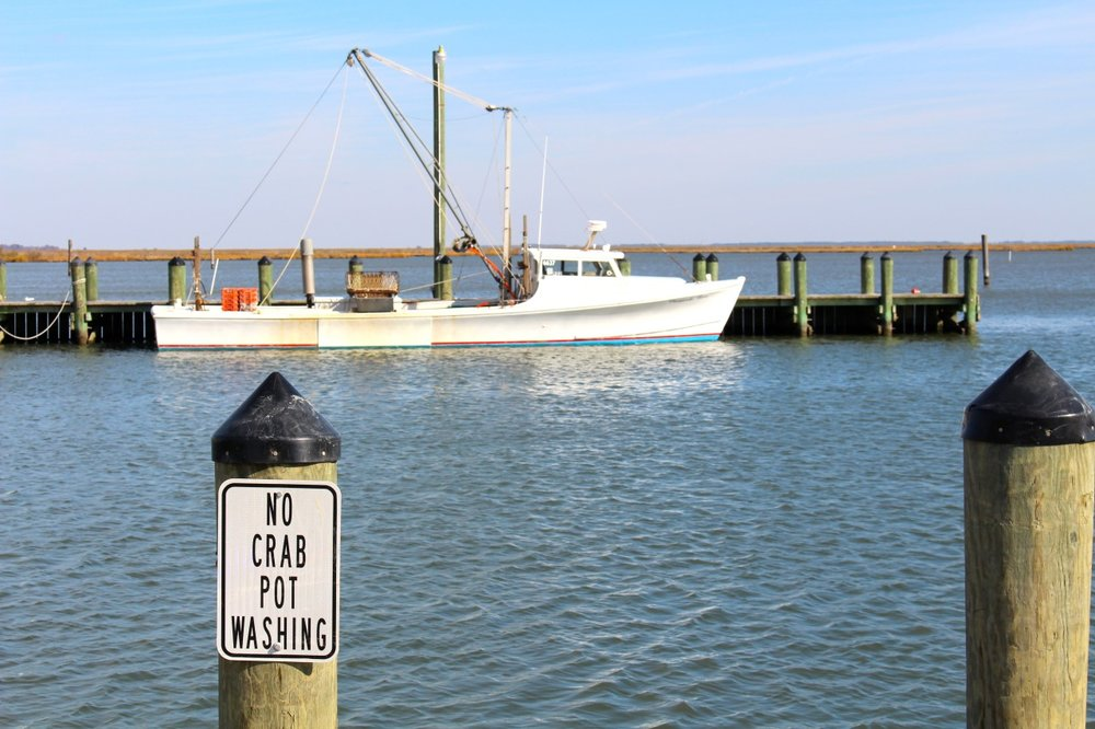 A workboat all ready for power dredging at a working waterfront on Deal Island, Maryland. Image by author.