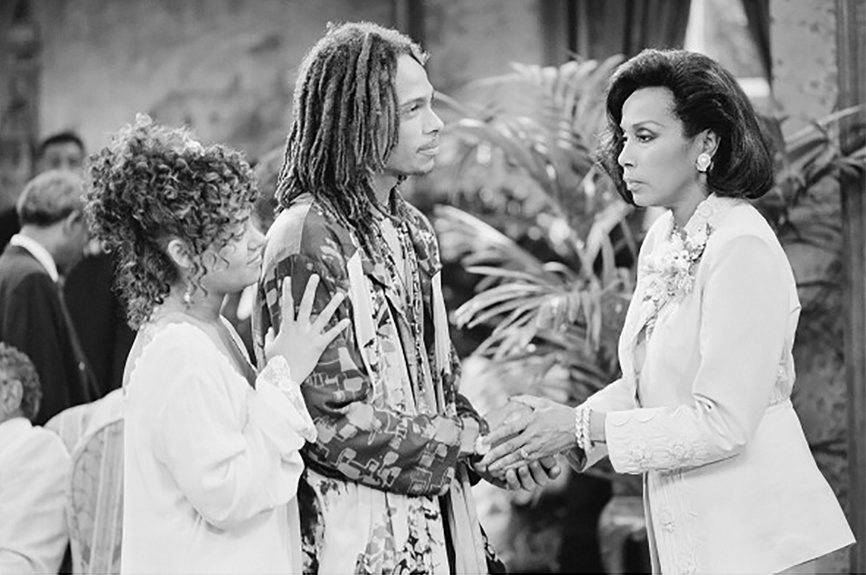 In a classic scene from  A Different World,  Freddie (Cree Summer) and Shazza (Gary) receive a less-than-welcoming acknowledgement from Marion Gilbert (Diahann Carroll) at Whitley's wedding. Photo: NBC/Getty Images