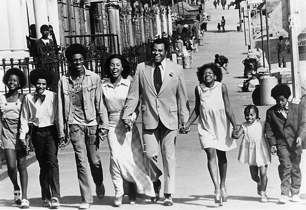 Claudine (Diahann Carroll), her six children and new husband, Rupert (James Earl Jones) walk triumphantly down a Harlem street on their wedding day.