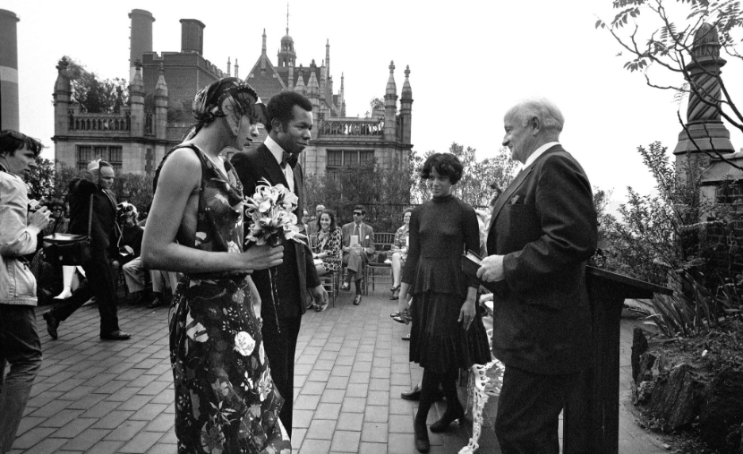 """Auntie"" June Murphy's  surprise 1970's wedding da  y  to New York designer, Jon Haggins, wearing a dress of his design. Photographer Bill Cunningham shooting the festivities on the far left. Photo: Jack Manning/New York Times."