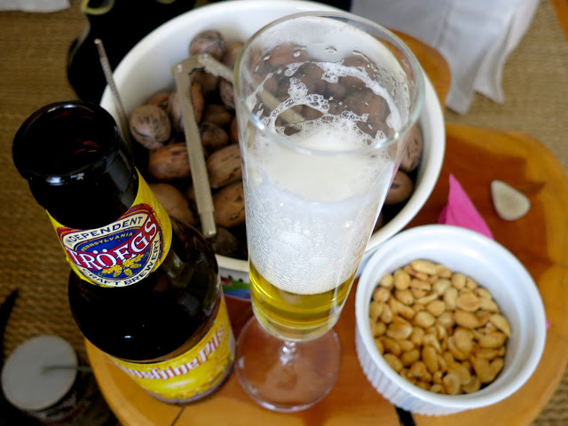 beer in champagne class with peanuts