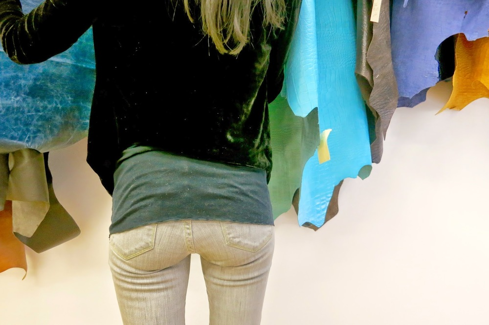 leather hides, butt shot, grey jeans, velvet jacket