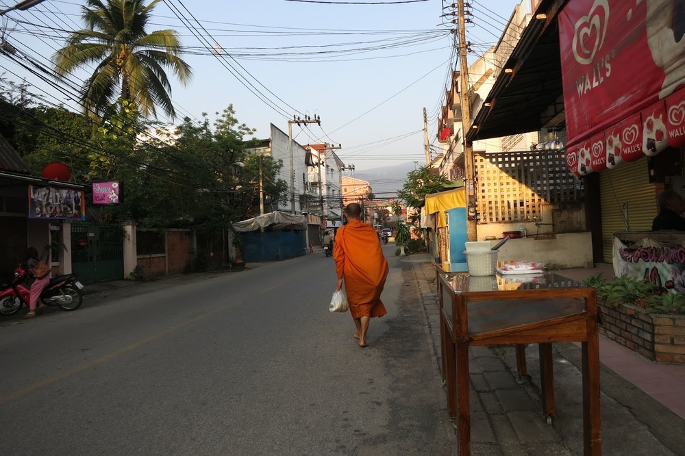 BUDDHIST MONK WALKING IN CHIANG MAI
