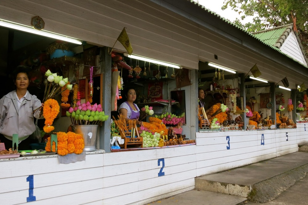 FLOWER OFFERINGS AT THAI TEMPLE ENTRANCE