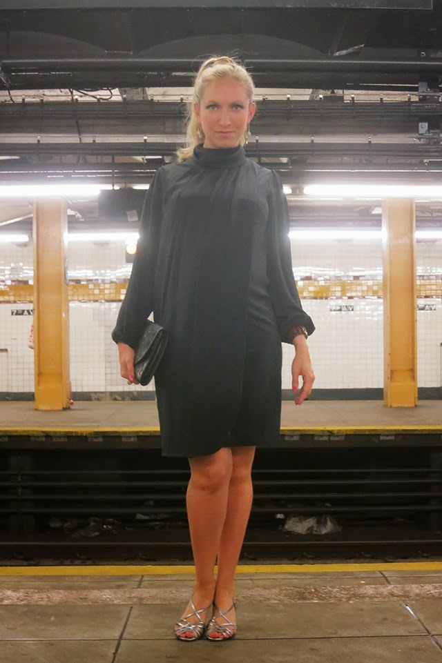 black tie attire_black dress_ blond pony tail_ silver strappy shoes_ nyc subway