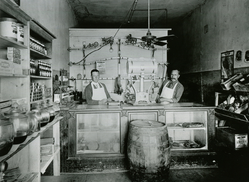 Ramon Andrade , right, with his partner inside Prettyman's Market on Main Street in Casa Grande, Arizona circa 1920 .  Casa Grande Valley Historical Society
