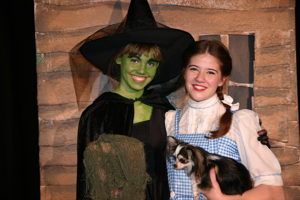 The Wicked Witch of the West (Elaine George) and Dorothy (Charlotte Myhre)