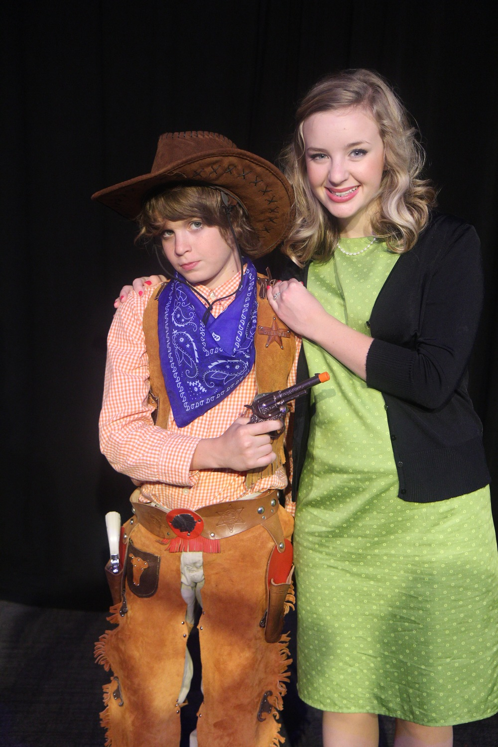 Mike Teavee (Finn Pope) and Mrs. Teavee (Kathryn Merrell)