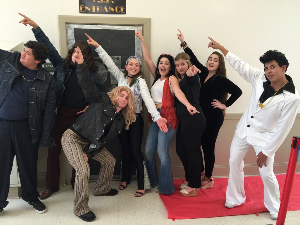 Ms. Rohrbach's students pose after completing their 70's decade project.  Photo courtesy of Jen Rohrbach