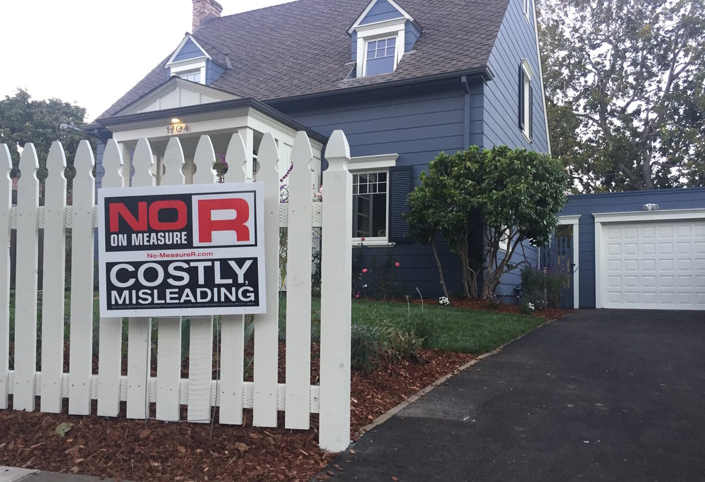 "A Burlingame resident stakes a sign in their front yard reading ""NO ON MEASURE R. COSTLY, MISLEADING."" These signs can be seen throughout Burlingame."