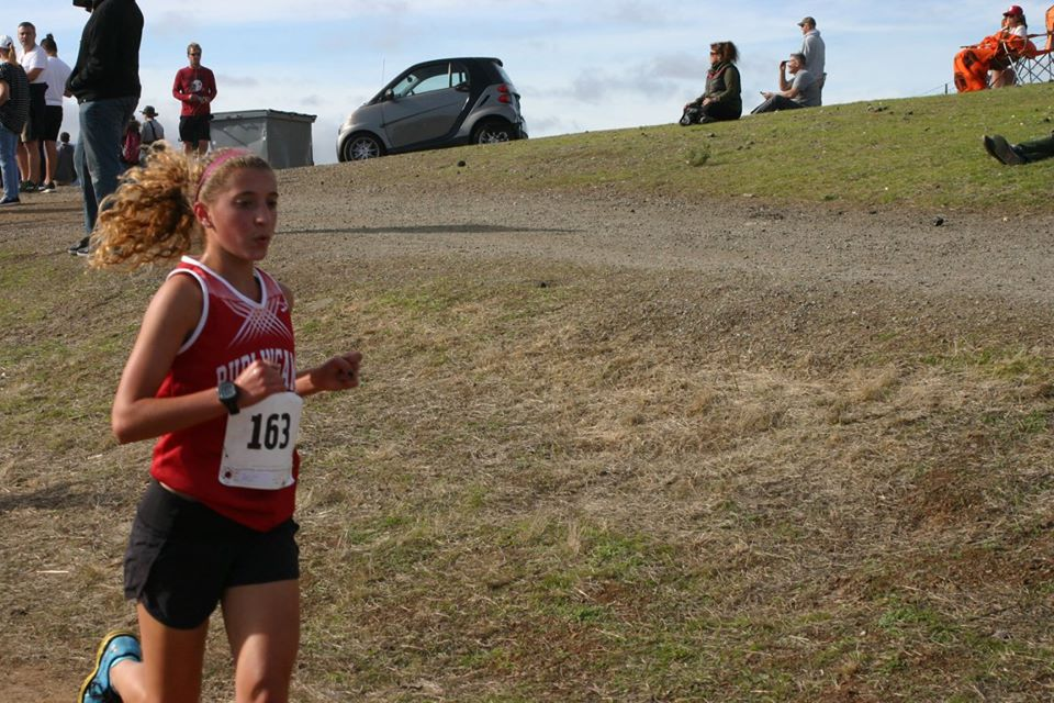 Jillian Jordan runs on the Crystal Springs cross country course during the PAL meet.