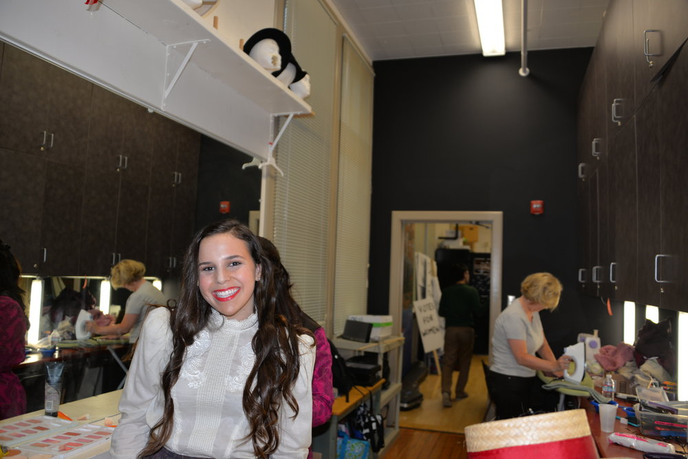 Madeline Levine smiles backstage during this year's musical, Hello Dolly.