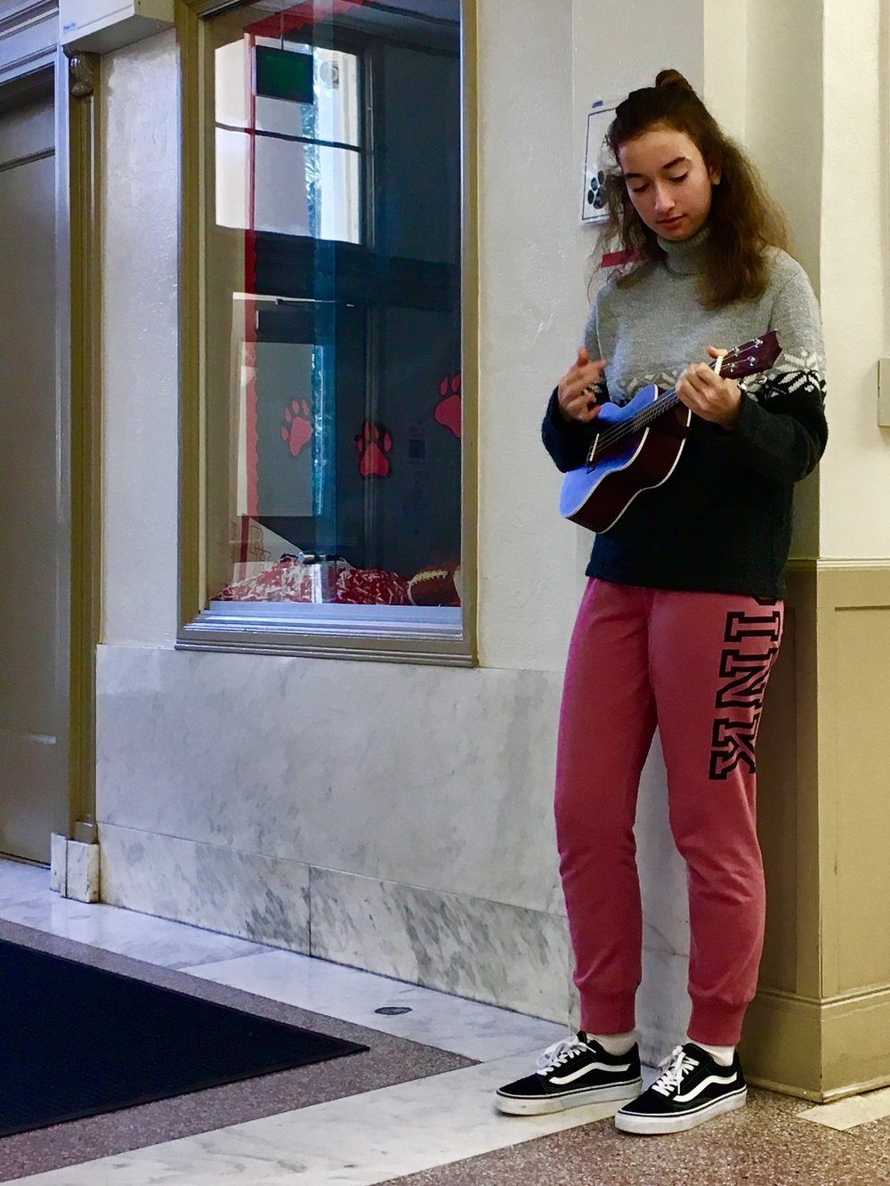 Lily Page jams out on the ukulele for fun.