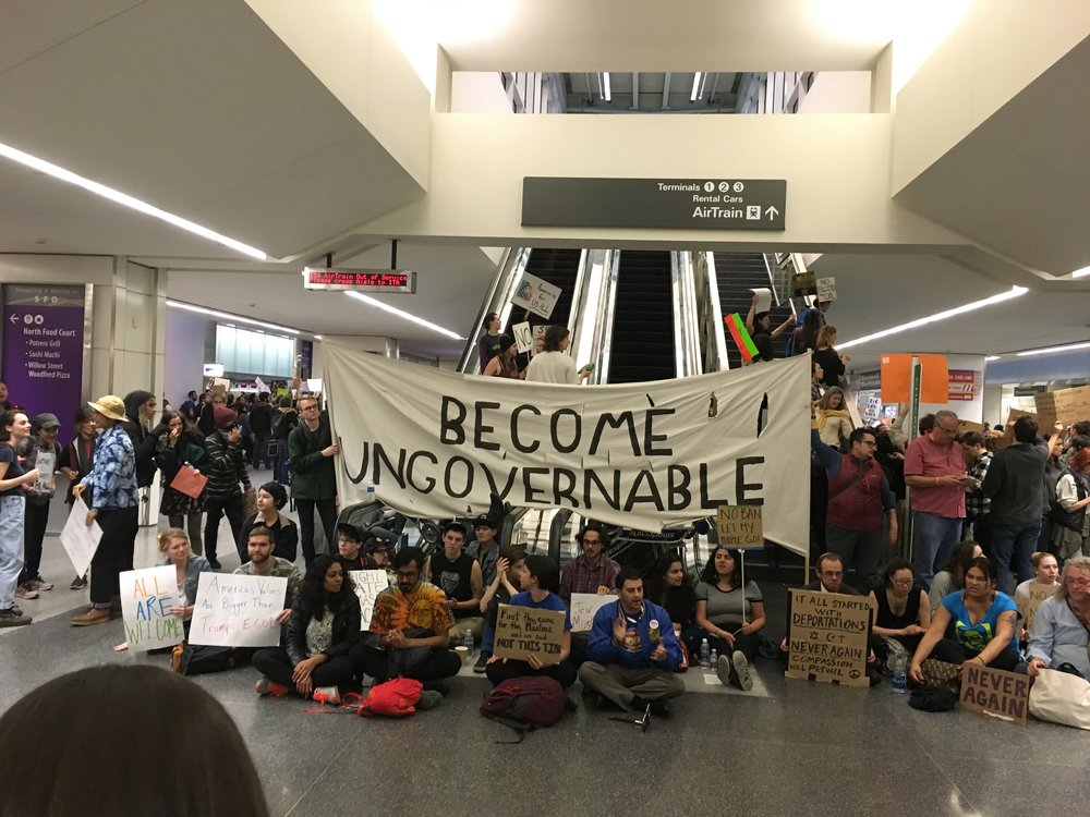 Protesters in opposition to Trump's immigration executive order demonstrate in the San Francisco International Airport.