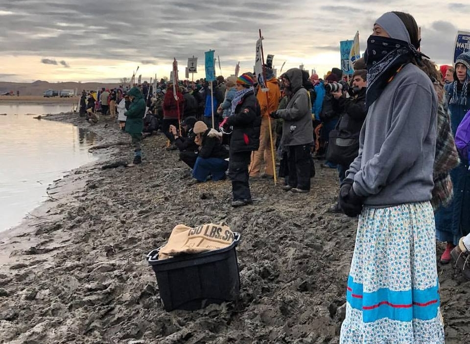 Protestors line along Lake Oahe, North Dakota to block the construction of the Dakota Access Pipeline. At the time this photo was taken, videos surfaced showing officers firing rubber bullets, deploying tear gas and spraying water at the protesters in freezing weather.