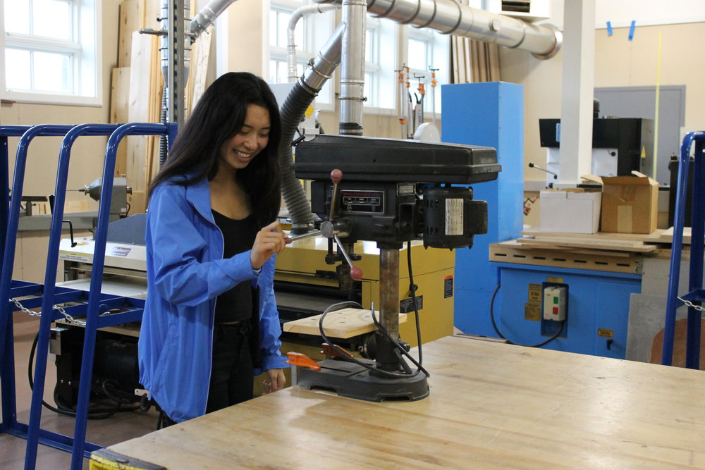 Former Exploring Tech student Nicole Chin practices using machinery in the tech lab.