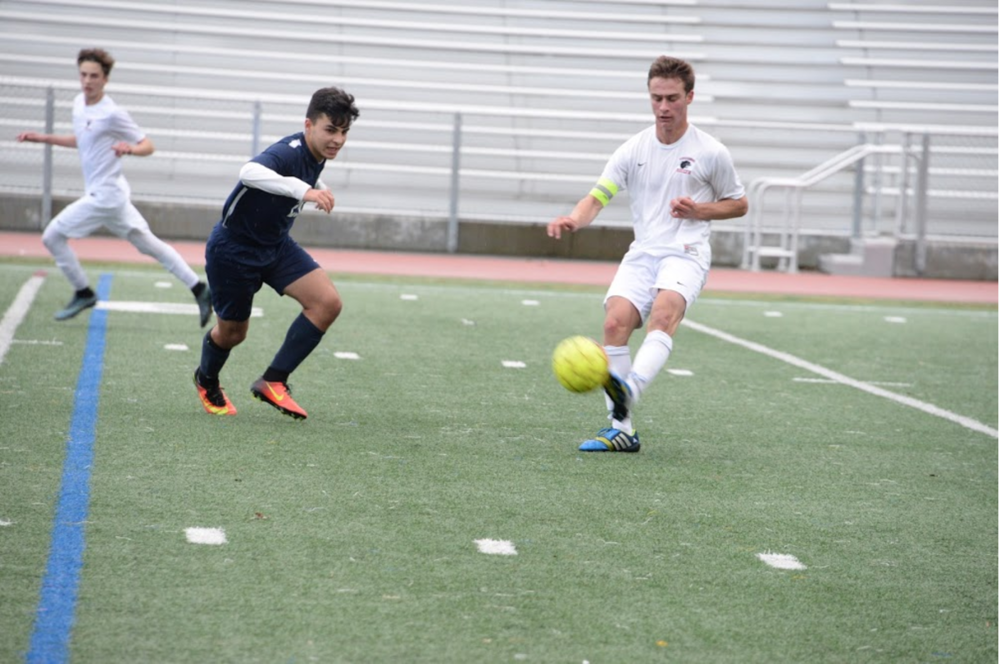 Junior and co-captain Gabe Hyman traps the ball in the boys game against Carlmont earlier in the season.