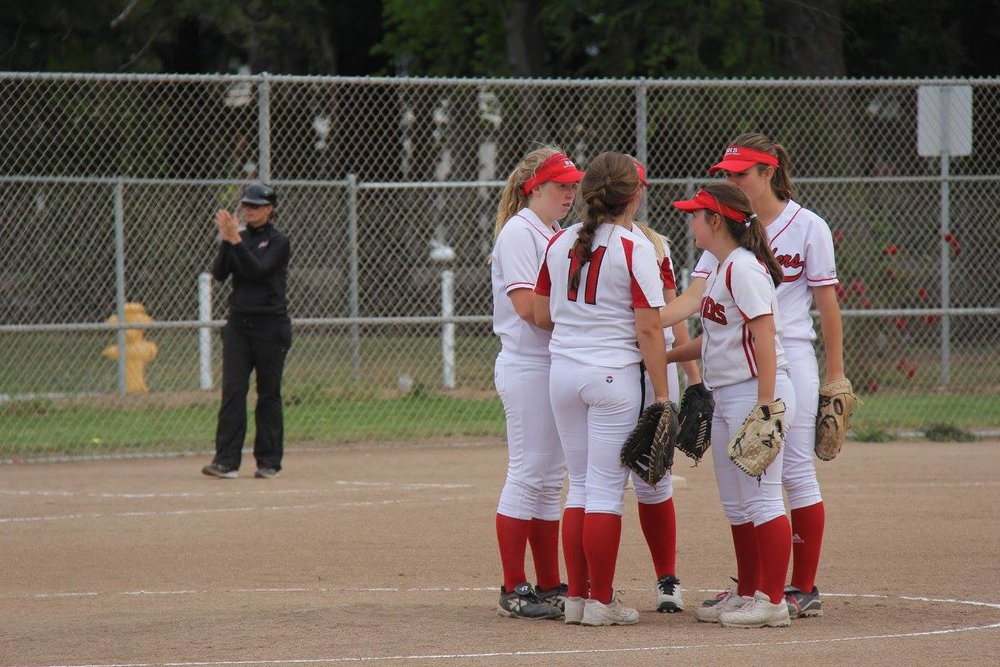 Pitcher Chloe McNamara and the infielders discuss strategy during a game last season.