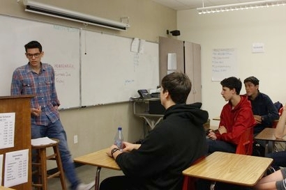 Club president Matthew Zell leads one of the first meetings by discussing current events.