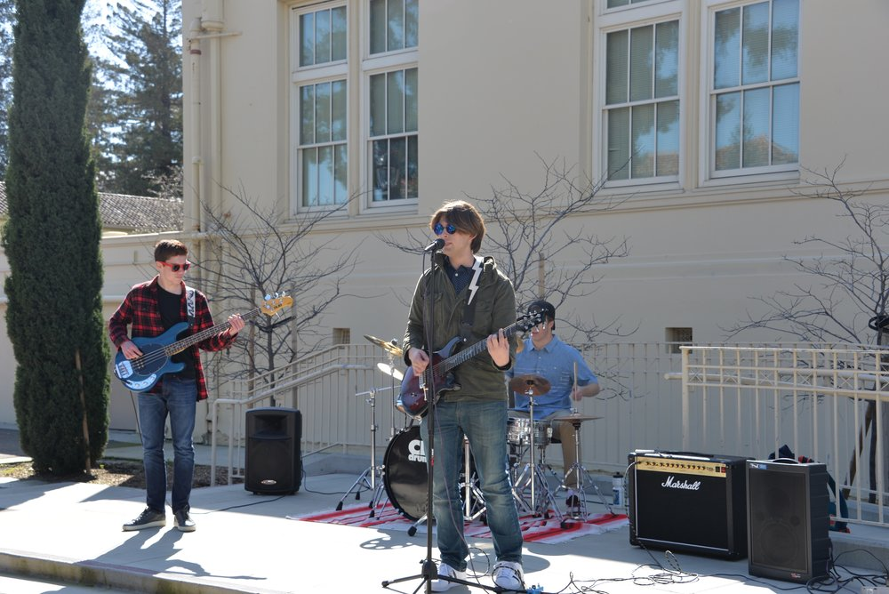 "The Letdowns play the song ""Wonderwall"" by Oasis at the Battle of the Bands during lunch on Feb. 23."