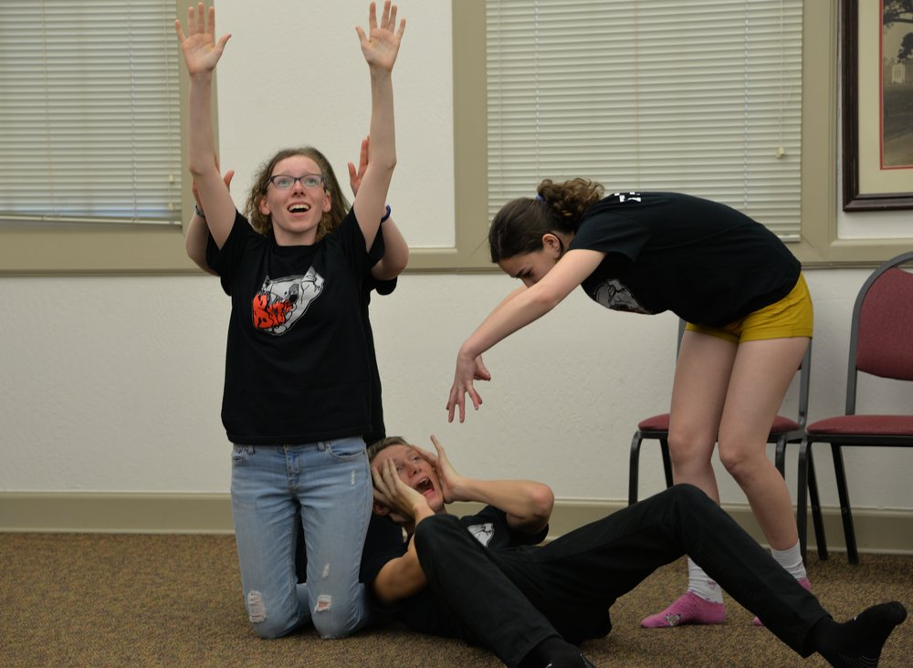 Junior Brady Kiesling, junior Lola McManus, junior Viva Freedman, and another performer freeze at the conclusion of their skit.