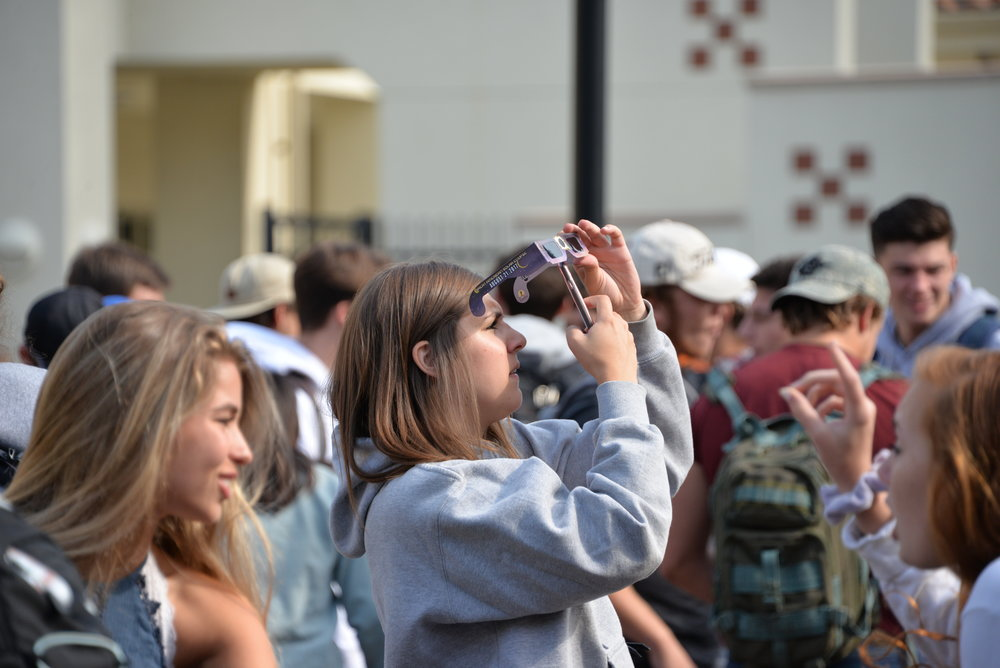 Senior Kennedy Johnson takes a picture of the eclipse.
