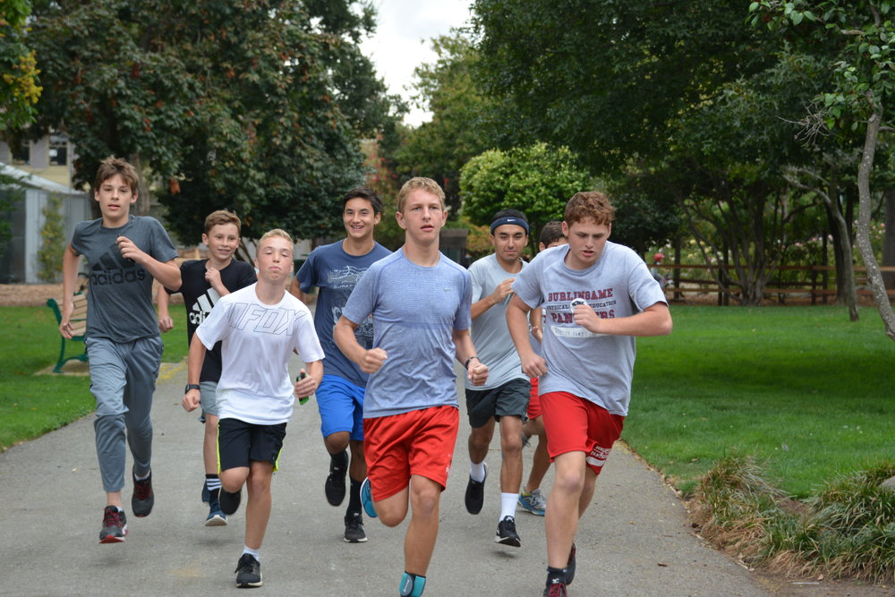 Cross Country runners begin their Thursday food run, in which students run to their food joint of choice.