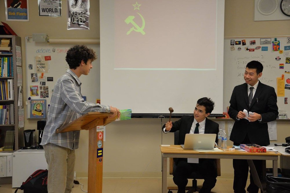 Chairman Anton Bobrov and delegate Zach Gold debate during their committee in the crisis Cold War simulation.