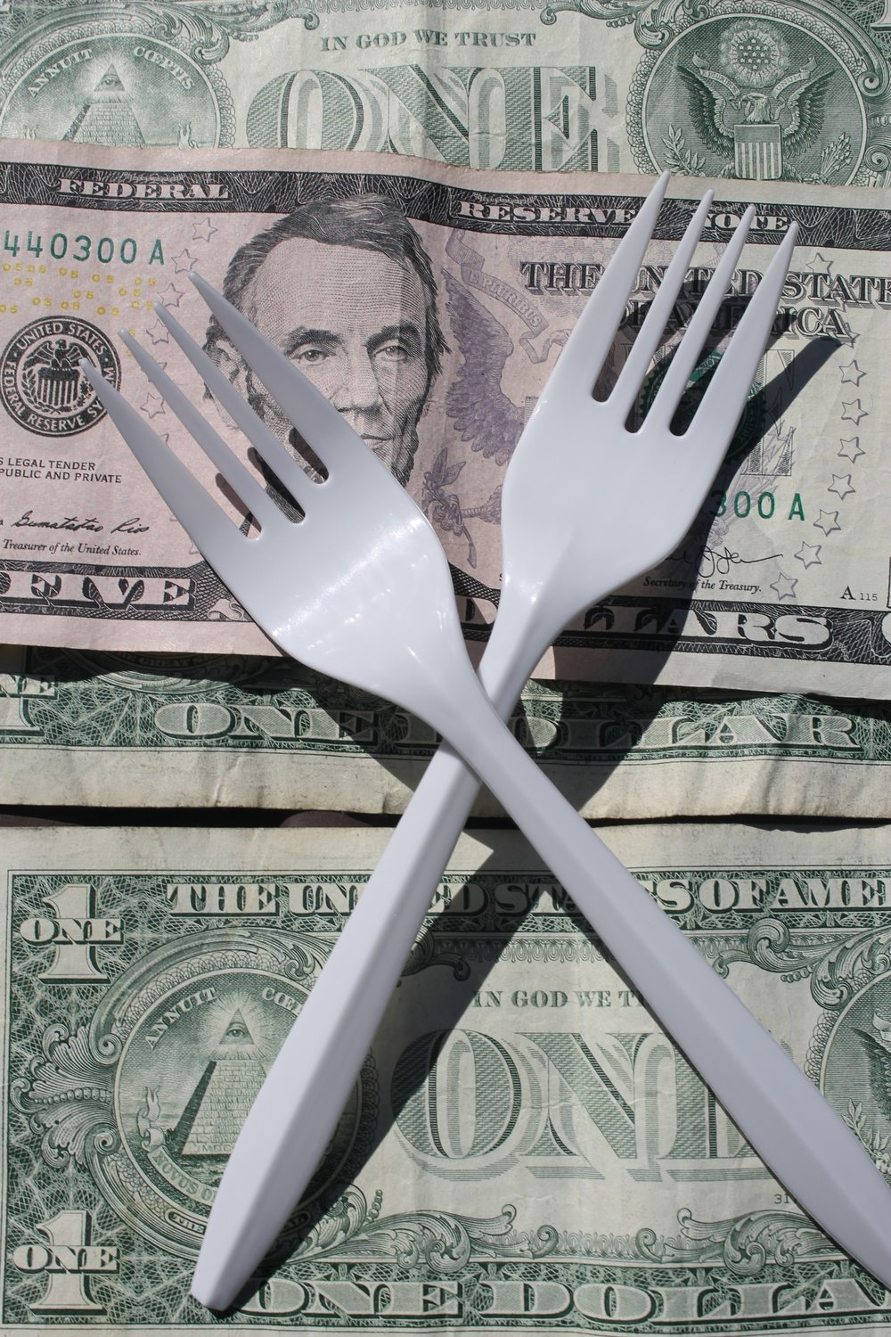 Any amount is too much to pay for utensils that should be free.