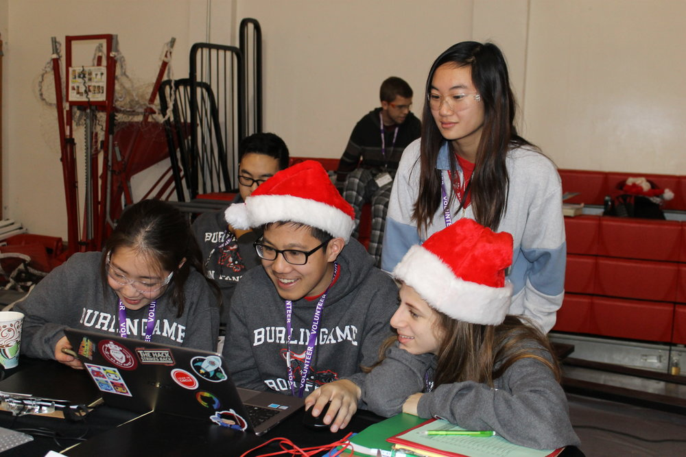 Senior Serena Haddad and juniors Nicole Louie, Christopher Sung, and Erina Yamaguchi compile a Spotify playlist for the competition.