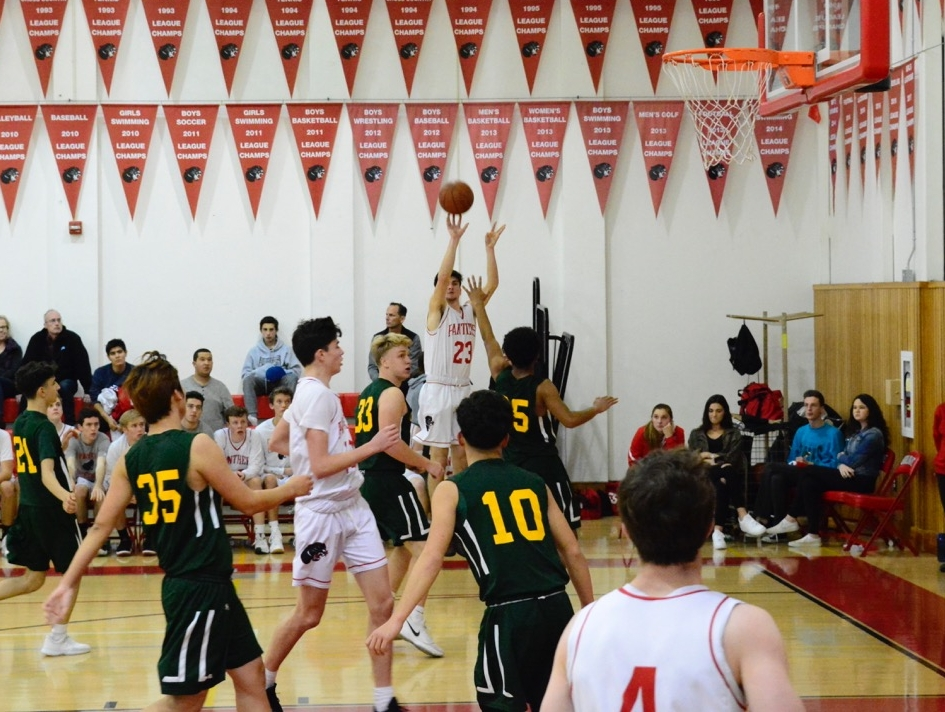 Senior Robert Uhrich sinks a three in the boys' varsity basketball game against Cappuccino High School on Jan. 19. The Panthers lost in overtime 46-41.