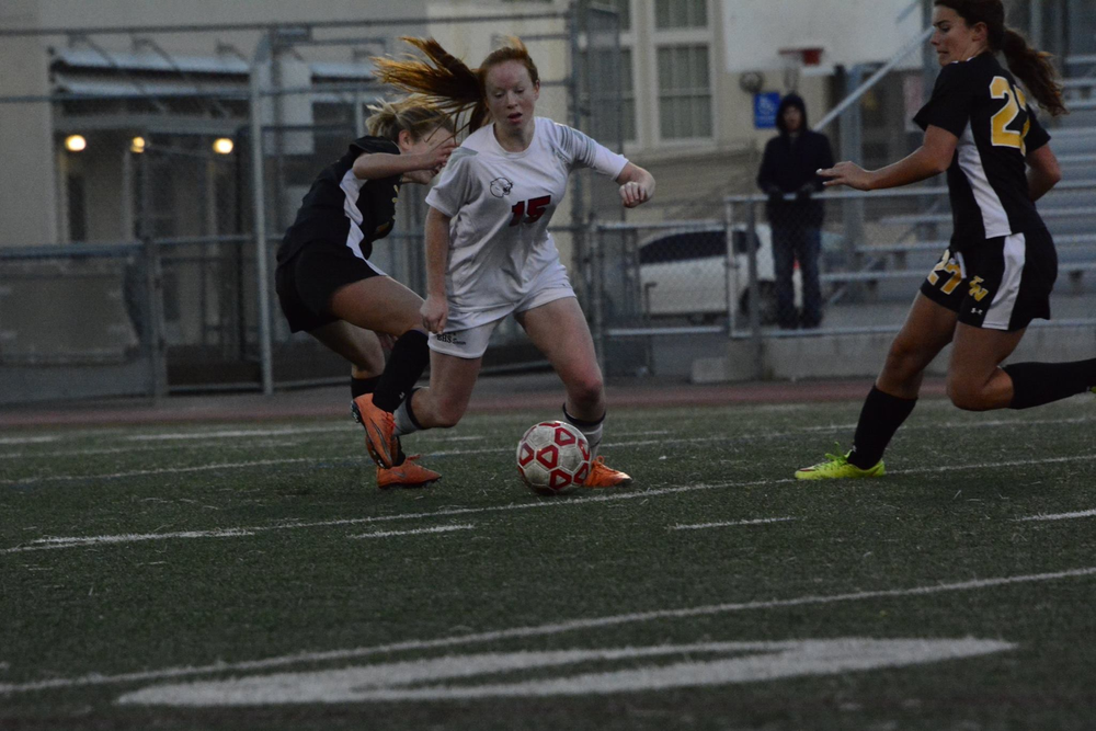 Freshman Kathleen Glynn powers past a Terra Nova player on senior night.