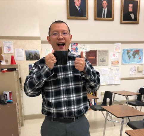 Chin poses in his classroom