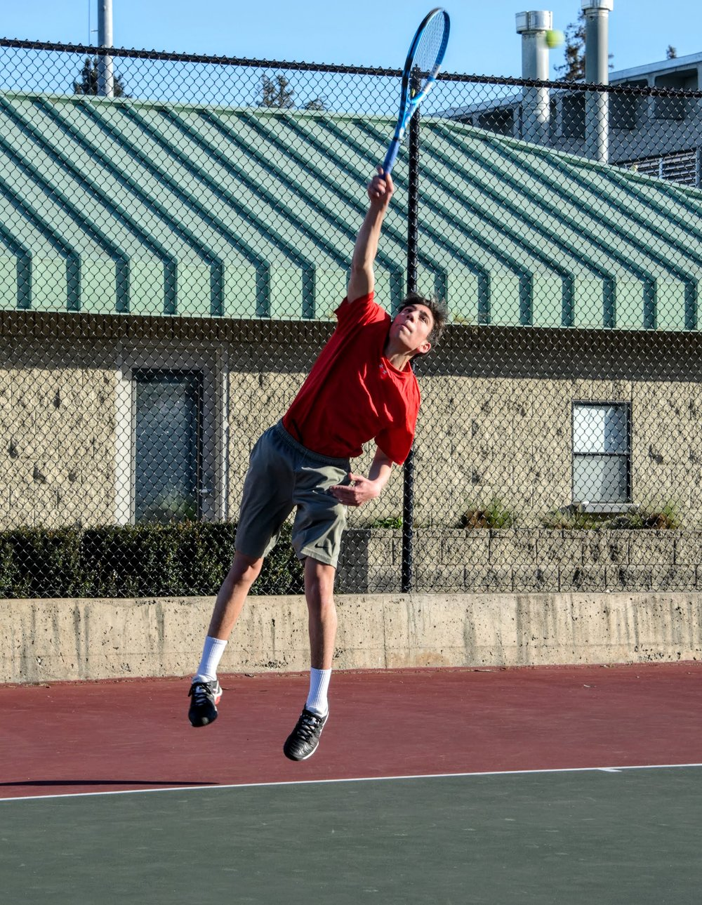 Senior Cale Goodman, the No. 1 singles player last year, returns a ball at a Feb. 27 home game.