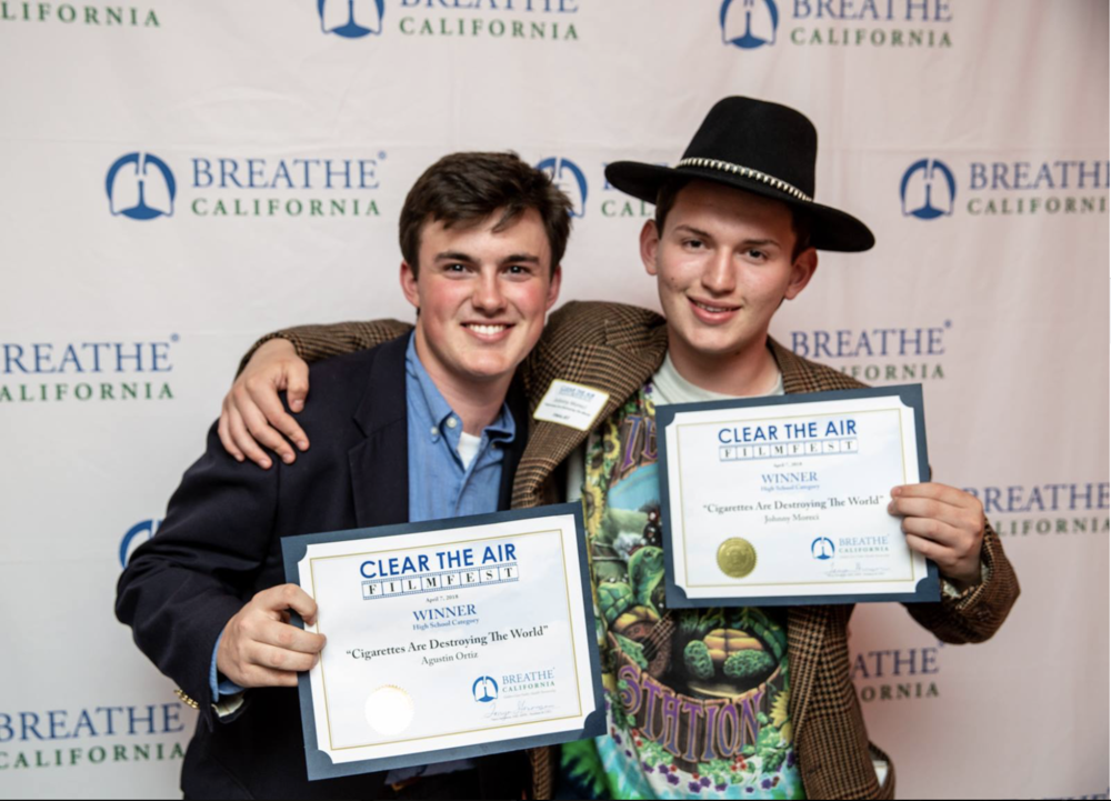 "Agustin Ortiz and Johnny Moreci win the high school category with their film ""Cigarettes Are Destroying The World."""