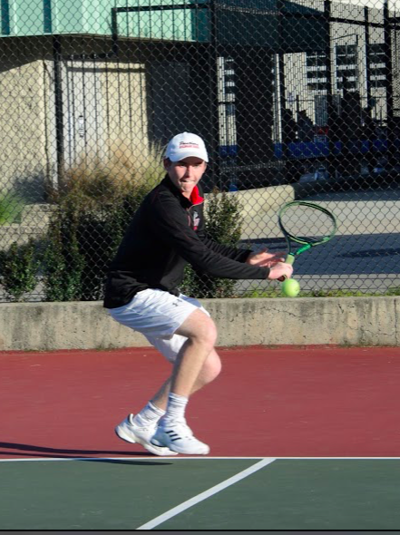 Senior Oliver Nix returns the ball at their last game against Hillsdale on April 12