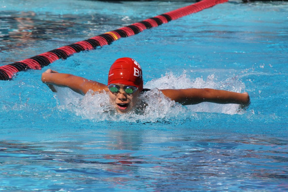 Varsity swimmer sophomore Cherilyn Yu races in the 100 meter.