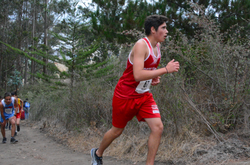 Sophomore Chris Percia runs up Cougar Hill during the first meet of the season in Half Moon Bay.