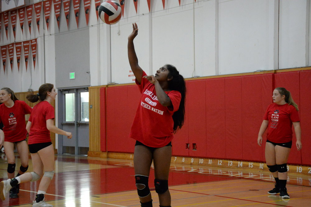 Sophomore setter Neha Bandrapalli practices her volleyball skills before a home game against Hillsdale High School