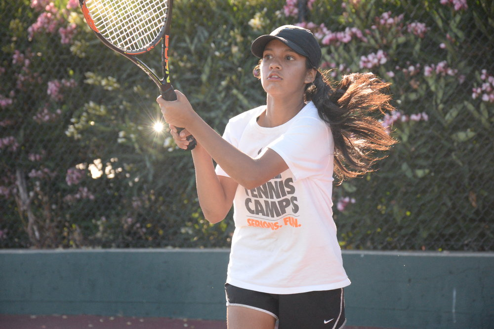 Number two varsity singles player Vedika Bhaumik returns a serve in the September 5th game against Menlo Atherton.