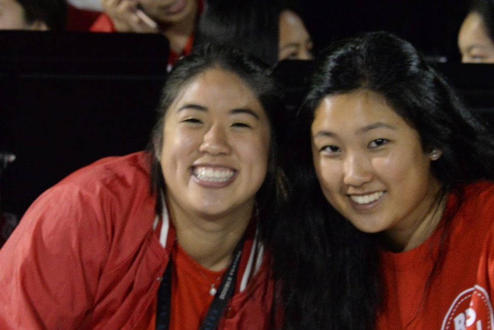 Seniors Katrina Lee and Madison Kong conduct the marching band at a football game against Half moon bay high school on September 21.