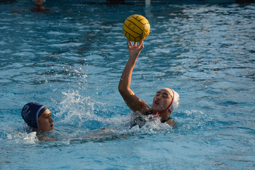 Junior Isabel Downey plays defense against Carlmont player