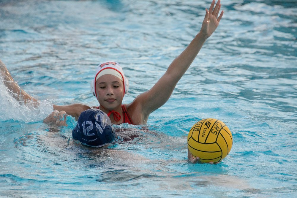 Varsity player Alyssa Archie tenaciously defends the ball at Carlmont game.