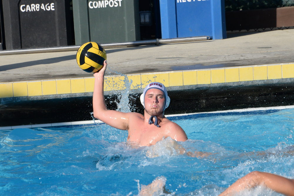 Senior Lucca Aliaga passes the ball in the Panthers' game against Menlo Atherton
