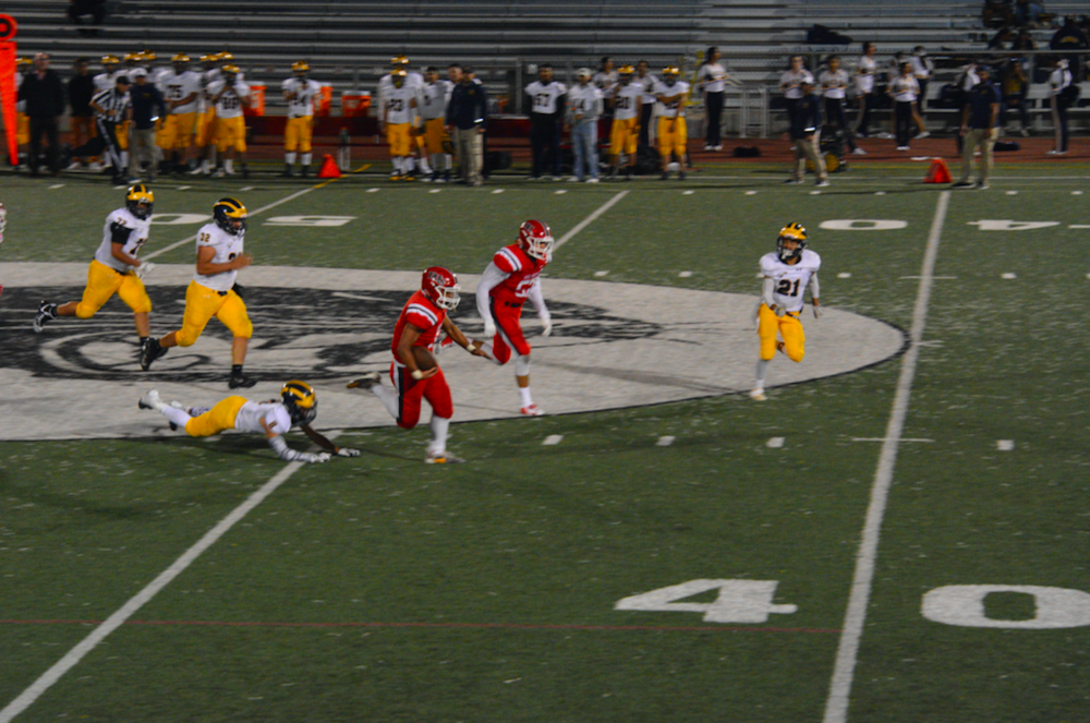 Burlingame running back Curtis Lauti breaks past the secondary for a 61 yard touchdown run against Alvarez.