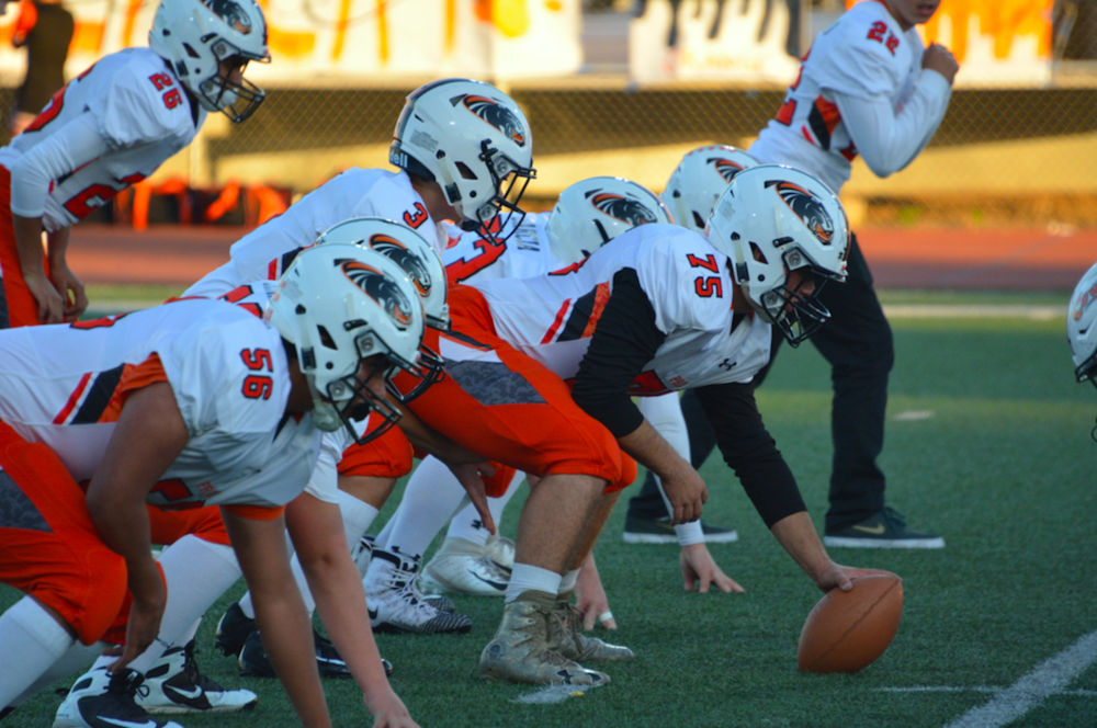 William Moffit runs drills with his Half Moon Bay offense in preperation for its showdown with a strong San Mateo defense.